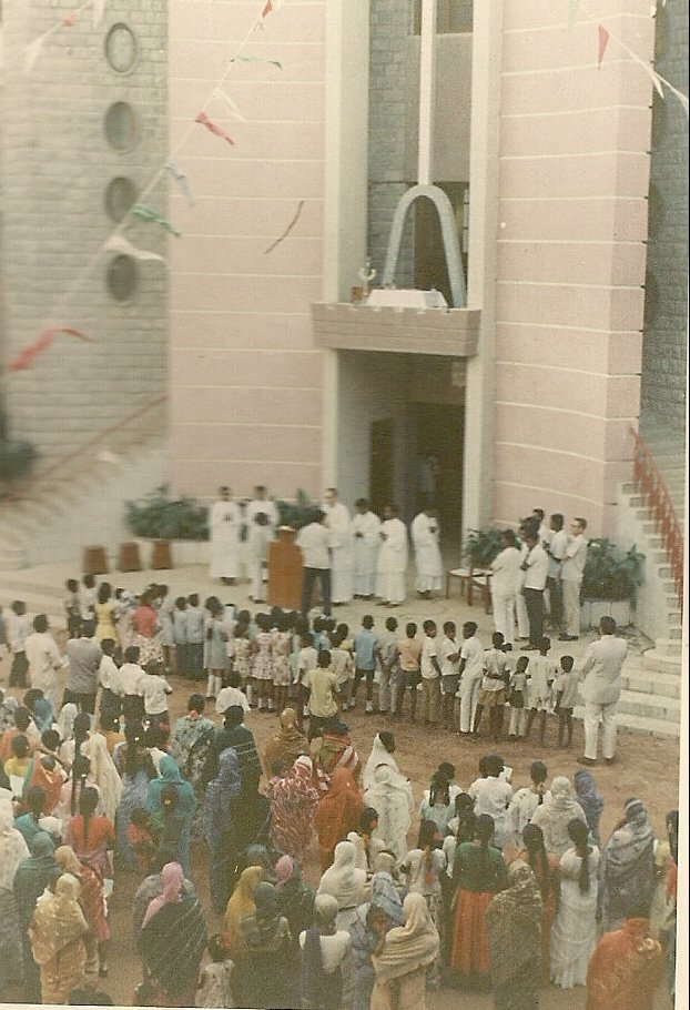 Me presiding over a function for people from the local parish in front of our college chapel.