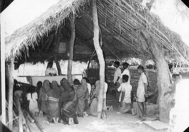 Mass celebrated in an open prayer hut.