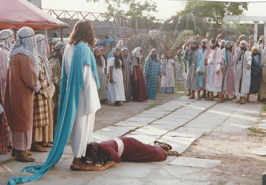 The pharisees throw the woman caught in adultery before Jesus' feet